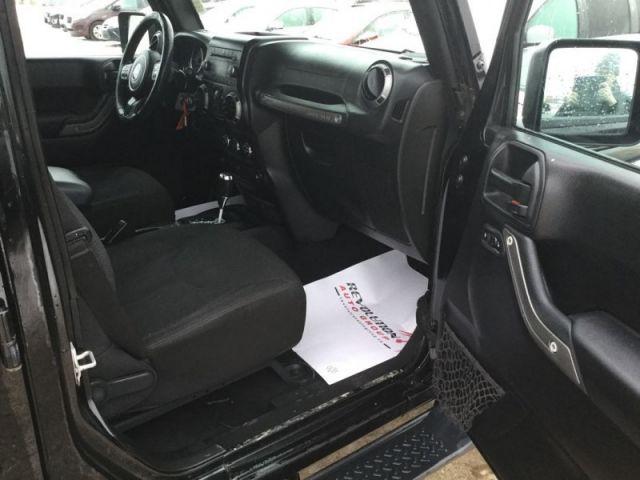 2015 Jeep Wrangler Unlimited Sport  -  - Air - Tilt - $328.57 B/W